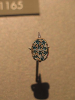 <em>Scarab with Scrolls</em>, ca. 1630-1539 B.C.E. Steatite, glaze, 3/16 x 9/16 x 3/8 in. (0.5 x 1.4 x 1 cm). Brooklyn Museum, Gift of Evangeline Wilbour Blashfield, Theodora Wilbour, and Victor Wilbour honoring the wishes of their mother, Charlotte Beebe Wilbour, as a memorial to their father Charles Edwin Wilbour, 16.598. Creative Commons-BY (Photo: Brooklyn Museum, CUR.16.598_erg2.jpg)
