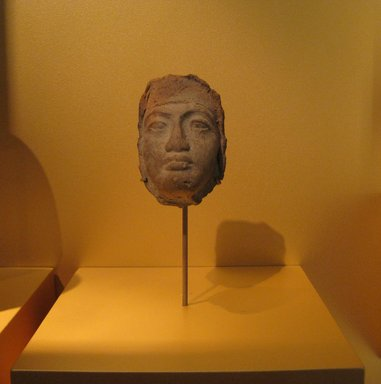 <em>Mask of a Man's Face</em>, ca. 1352-1332 B.C.E. Terracotta, 4 1/4 x 2 13/16 in. (10.8 x 7.2 cm). Brooklyn Museum, Gift of Evangeline Wilbour Blashfield, Theodora Wilbour, and Victor Wilbour honoring the wishes of their mother, Charlotte Beebe Wilbour, as a memorial to their father, Charles Edwin Wilbour, 16.61. Creative Commons-BY (Photo: Brooklyn Museum, CUR.16.61_erg456.jpg)