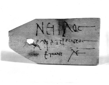 <em>Mummy Tag of Neilos</em>, ca. 150-250 B.C.E. Wood, pigment, 2 5/16 × 4 9/16 in. (5.8 × 11.6 cm). Brooklyn Museum, Gift of Evangeline Wilbour Blashfield, Theodora Wilbour, and Victor Wilbour honoring the wishes of their mother, Charlotte Beebe Wilbour, as a memorial to their father, Charles Edwin Wilbour, 16.644. Creative Commons-BY (Photo: Brooklyn Museum, CUR.16.644_NegA_print_bw.jpg)