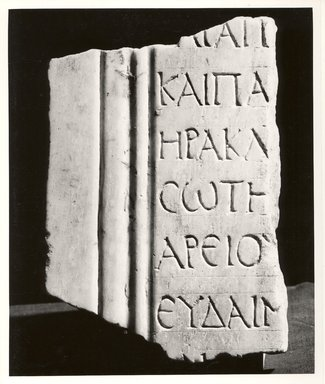 <em>Stela Fragment with a List of Names</em>, 200-300 C.E. Marble, 6 3/8 x 4 1/2 in. (16.2 x 11.4 cm). Brooklyn Museum, Gift of Evangeline Wilbour Blashfield, Theodora Wilbour, and Victor Wilbour honoring the wishes of their mother, Charlotte Beebe Wilbour, as a memorial to their father, Charles Edwin Wilbour, 16.656. Creative Commons-BY (Photo: Brooklyn Museum, CUR.16.656_negA_bw.jpg)
