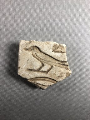 <em>Relief Fragment with Inscription</em>, ca. 1352-1336 B.C.E. Limestone, 2 7/8 x 3 1/8 in. (7.3 x 8 cm). Brooklyn Museum, Gift of Evangeline Wilbour Blashfield, Theodora Wilbour, and Victor Wilbour honoring the wishes of their mother, Charlotte Beebe Wilbour, as a memorial to their father, Charles Edwin Wilbour, 16.696. Creative Commons-BY (Photo: , CUR.16.696_view01.jpg)