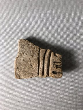 <em>Part of Nefertiti's Cartouche, probably from a Statue Base</em>, ca. 1352-1336 B.C.E. Sandstone-quartzite, 2 13/16 x 2 3/8 in. (7.1 x 6 cm) Measurements: Height 7.1 cm., Width 6 cm. Brooklyn Museum, Gift of Evangeline Wilbour Blashfield, Theodora Wilbour, and Victor Wilbour honoring the wishes of their mother, Charlotte Beebe Wilbour, as a memorial to their father, Charles Edwin Wilbour, 16.708. Creative Commons-BY (Photo: , CUR.16.708_view01.jpg)