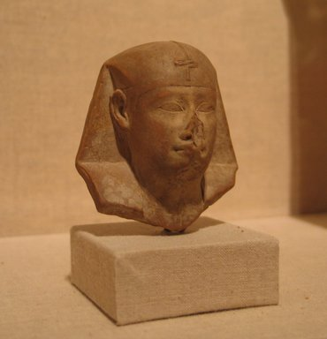 <em>Royal Bust</em>, 4th century B.C.E. Limestone, 2 5/16 x 2 3/16 x 1 1/4 in. (5.9 x 5.6 x 3.1 cm). Brooklyn Museum, Gift of Evangeline Wilbour Blashfield, Theodora Wilbour, and Victor Wilbour honoring the wishes of their mother, Charlotte Beebe Wilbour, as a memorial to their father, Charles Edwin Wilbour, 16.76. Creative Commons-BY (Photo: Brooklyn Museum, CUR.16.76_wwg8.jpg)