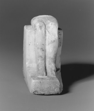 <em>Lower part of seated Heb-Sed Statue of Pepy II</em>, ca. 2288-2224/2194 B.C.E. Egyptian alabaster (calcite), 4 × 1 7/8 × 4 1/8 in. (10.1 × 4.8 × 10.5 cm). Brooklyn Museum, Gift of Evangeline Wilbour Blashfield, Theodora Wilbour, and Victor Wilbour honoring the wishes of their mother, Charlotte Beebe Wilbour, as a memorial to their father, Charles Edwin Wilbour, 16.80. Creative Commons-BY (Photo: Brooklyn Museum, CUR.16.80_NegA_print_bw.jpg)