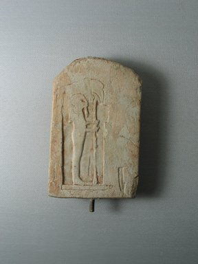 <em>Unfinished Votive Stela of Ptah</em>, ca. 1539-1075 B.C.E. Limestone, 5 9/16 × 3 3/8 × 3/4 in. (14.1 × 8.6 × 1.9 cm). Brooklyn Museum, Gift of Evangeline Wilbour Blashfield, Theodora Wilbour, and Victor Wilbour honoring the wishes of their mother, Charlotte Beebe Wilbour, as a memorial to their father, Charles Edwin Wilbour, 16.91. Creative Commons-BY (Photo: Brooklyn Museum, CUR.16.91_view3.jpg)