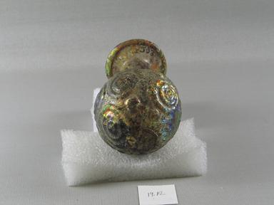 Roman. <em>Sprinkler</em>, 4th-5th century C.E. Glass, 4 1/2 x Diam. 2 11/16 in. (11.5 x 6.8 cm). Brooklyn Museum, Robert B. Woodward Memorial Fund, 19.12. Creative Commons-BY (Photo: Brooklyn Museum, CUR.19.12_view1.jpg)