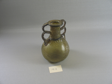 Roman. <em>Bottle</em>, ca. 4th century. Glass, 4 1/2 x greatest diam. 3 1/8 in. (11.5 x 7.9 cm). Brooklyn Museum, Robert B. Woodward Memorial Fund, 19.13. Creative Commons-BY (Photo: Brooklyn Museum, CUR.19.13_view1.jpg)