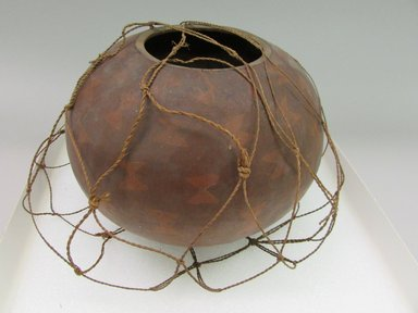 Hawaiian. <em>Netted Gourd Bowl (Umeke Pawehe)</em>, 19th century (possibly). Gourd, pigment, fiber, 5 7/8 x 8 7/8 x 8 7/8 in. (14.9 x 22.5 x 22.5 cm). Brooklyn Museum, Brooklyn Museum Collection, 19063. Creative Commons-BY (Photo: Brooklyn Museum, CUR.19063.jpg)