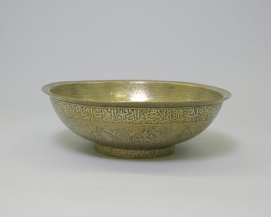 <em>Divination Bowl with Inscriptions and Zodiac Signs</em>, mid-16th century. Copper alloy (brass), engraved with repoussé center, 3 3/4 x 8 1/2 x 8 1/2in. (9.5 x 21.6 x 21.6cm). Brooklyn Museum, Gift of Mrs. Charles K. Wilkinson in memory of her husband, 1989.149.7. Creative Commons-BY (Photo: Brooklyn Museum, CUR.1989.149.7_exterior1.jpg)