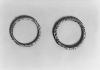 Inland Niger Delta. <em>Bracelet</em>, 16th century. Bronze, Diameter: 2 15/16 in. Brooklyn Museum, Gift of Drs. John I. and Nicole Dintenfass, 1989.173.4. Creative Commons-BY (Photo: , CUR.1989.173.4_1989.173.5_print_bw.jpg)