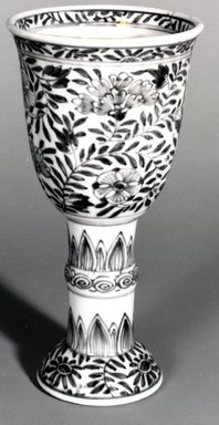 <em>Cup</em>, 1662-1722. Porcelain with cobalt-blue underglaze decoration, 5 5/8 x 2 7/8 in. (14.3 x 7.3 cm). Brooklyn Museum, Gift of Dr. Bertram H. Schaffner, 1989.179.2. Creative Commons-BY (Photo: Brooklyn Museum, CUR.1989.179.2_bw.jpg)