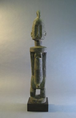 Dogon. <em>Standing Male Figure</em>, 19th century?. Wood, organic sacrificial materials, 19 1/2 x 3 1/2 x 3 in. (49.5 x 9.0 x 7.7 cm). Brooklyn Museum, The Adolph and Esther D. Gottlieb Collection, 1989.51.40. Creative Commons-BY (Photo: Brooklyn Museum, CUR.1989.51.40_front.jpg)