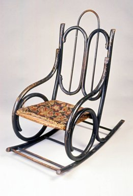 Attributed to Tyler Desk Company. <em>Child's Bentwood Rocking Chair</em>, ca. 1885. Ebonized bentwood, original upholstery, 28 1/8 x 14 x 25 1/4 in. (71.4 x 35.6 x 64.1 cm). Brooklyn Museum, Gift of Joseph V. Garry, 1989.60.2. Creative Commons-BY (Photo: Brooklyn Museum, CUR.1989.60.2.jpg)