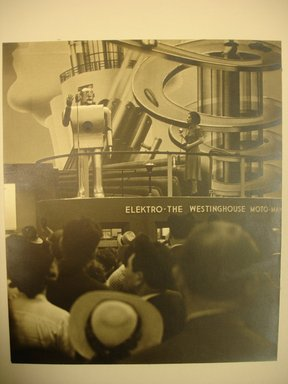 John Albok (American, born Hungary, 1894-1982). <em>First Moto Man, Westinghouse Exhibit (World's Fair)</em>, 1939. Gold toned gelatin silver photograph, 10 3/4 x 9 in. (27.3 x 22.9 cm). Brooklyn Museum, Gift of Ilona Albok Vitarius, 1990.122.10. © artist or artist's estate (Photo: Brooklyn Museum, CUR.1990.122.10.jpg)