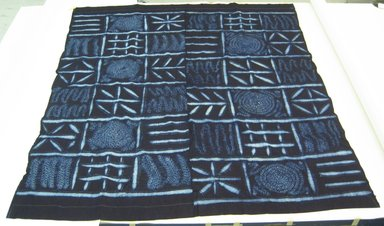 Yorùbá. <em>Wrapper (Adire Alabere)</em>, 20th century. Commercial cotton, synthetic indigo dye, 64 1/2 × 73 in. (163.8 × 185.4 cm). Brooklyn Museum, Purchased with funds given by Frieda and Milton F. Rosenthal, 1990.132.9. Creative Commons-BY (Photo: Brooklyn Museum, CUR.1990.132.9_overall.jpg)