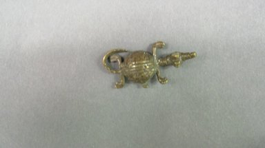 Akan. <em>Gold-weight (abrammuo): crocodile</em>, ca. 1700-1900. Copper alloy, length: 3 in. (length: 4.3 cm). Brooklyn Museum, Gift of Shirley B. Williams, 1990.221.27. Creative Commons-BY (Photo: Brooklyn Museum, CUR.1990.221.27.jpg)