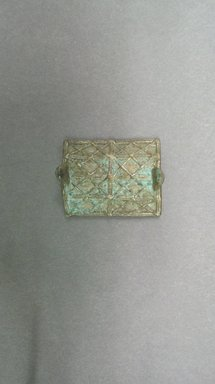 Akan. <em>Gold-weight (abrammuo): shield</em>, ca. 1700-1900. Copper alloy, length: 3 in. (length: 5.1 cm). Brooklyn Museum, Gift of Shirley B. Williams, 1990.221.48. Creative Commons-BY (Photo: Brooklyn Museum, CUR.1990.221.48.jpg)