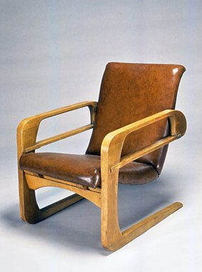 "Kem Weber (American, born Germany, 1889-1963). <em>Armchair (""Airline Chair"")</em>, 1934-1935. Wood, Naugahyde, leather, metal, 34 1/4 x 25 x 34 1/2 in. (87 x 63.5 x 87.6 cm). Brooklyn Museum, Modernism Benefit Fund, 1991.104. Creative Commons-BY (Photo: Brooklyn Museum, CUR.1991.104.jpg)"