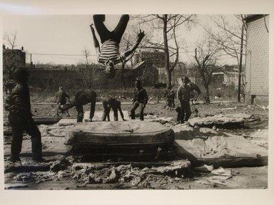 Helen M. Stummer (American, born 1936). <em>Flipping</em>, 1988; Printed 1990. Gelatin silver photograph, sheet: 10 7/8 x 13 7/8 in. Brooklyn Museum, Gift of the artist, 1991.18.4. © artist or artist's estate (Photo: Brooklyn Museum, CUR.1991.18.4.jpg)