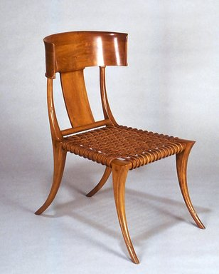 Terence Harold Robsjohn-Gibbings (British, 1905-1976, active America, 1930-1964). <em>Klismos Side Chair with Cushion</em>, 1961. Walnut, leather, fabric, Overall: 35 3/8 x 20 7/8 x 28 1/4 in. (89.9 x 53 x 71.8 cm). Brooklyn Museum, H. Randolph Lever Fund, 1991.197a-b. Creative Commons-BY (Photo: Brooklyn Museum, CUR.1991.197_view1.jpg)