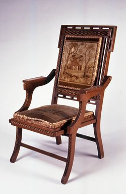 Edward W. Vaill (1861-1891). <em>Folding Armchair (reception) (Aesthetic Movement style)</em>, ca. 1880. Walnut, original upholstery, metal, 39 7/16 x 24 9/16 x 25 3/4 in. (100.2 x 62.4 x 65.4 cm). Brooklyn Museum, Bequest of DeLancey Thorn Grant in memory of her mother, Louise Floyd-Jones Thorn, by exchange, 1991.199. Creative Commons-BY (Photo: Brooklyn Museum, CUR.1991.199.jpg)