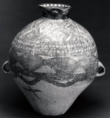 Yangshao. <em>Mortuary Urn</em>, 2200 B.C-2000 B.C.E. Earthenware, 15 13/16 x 13 9/16 in. (40.2 x 34.5 cm). Brooklyn Museum, Gift of Stanley J. Love, 1991.243.1. Creative Commons-BY (Photo: Brooklyn Museum, CUR.1991.243.1_bw.jpg)