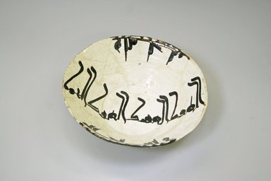 <em>Nishapur Bowl</em>, 9th-10th century. Buff earthenware, white engobe and brown slip, transparent glaze, 3 1/8 x 9 7/8 in. (7.9 x 25.1 cm). Brooklyn Museum, Gift of Lucile E. Selz, 1991.247.1. Creative Commons-BY (Photo: Brooklyn Museum, CUR.1991.247.1.jpg)