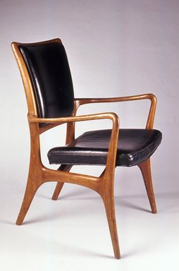 Vladimir Kagan (American, born Germany, 1927-2016). <em>Armchair</em>, ca. 1953. Walnut, leather, 34 1/2 x 22 7/16 x 25 in. (87.6 x 56.9 x 63.5 cm). Brooklyn Museum, Gift of the artist, 1991.255.2. Creative Commons-BY (Photo: Brooklyn Museum, CUR.1991.255.2.jpg)