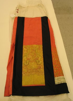 <em>Lady's Apron</em>, Qing Dynasty, 1644-1912. Satin brocaded with gold-wrapped thread, 38 1/2in. (97.8cm). Brooklyn Museum, Gift of Mr. and Mrs. Jerome J. Stenz, 1992.30.3. Creative Commons-BY (Photo: Brooklyn Museum, CUR.1992.30.3_overall.jpg)