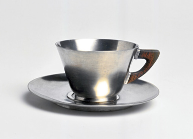 Marion Anderson Noyes (American, 1907-2002). <em>Cup and Saucer</em>, 20th century. Pewter, walnut, (a) Cup: 1 7/8 x 3 1/4 x 2 9/16 x 2 9/16 in. (4.8 x 8.3 x 6.5 x 6.5 cm). Brooklyn Museum, Gift of Marion Anderson Noyes, 1992.40.13a-b. Creative Commons-BY (Photo: Brooklyn Museum, CUR.1992.40.13a-b.jpg)