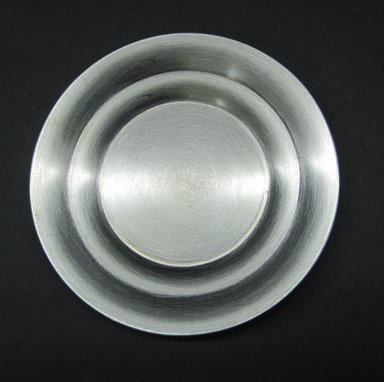 Marion Anderson Noyes (American, 1907-2002). <em>Miniature Plate</em>. Pewter, 1/4 x 3 in. (0.6 x 7.6 cm). Brooklyn Museum, Gift of Marion Anderson Noyes, 1992.40.14. Creative Commons-BY (Photo: Brooklyn Museum, CUR.1992.40.14_view2.jpg)