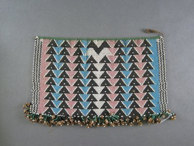 Zulu. <em>Apron</em>, late 19th or early 20th century. Glass beads, fiber, seeds, 6 3/8 x 10 1/4in. (16.2 x 26cm). Brooklyn Museum, Gift of Thomas Alexander, 1992.66.2. Creative Commons-BY (Photo: Brooklyn Museum, CUR.1992.66.2_overall.jpg)