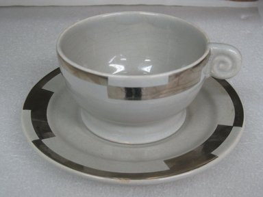 Jean Luce (French, 1895-1964). <em>Cup and Saucer</em>, ca. 1930. Glazed earthenware, a) cup: 2 1/4 x 4 1/4 x 3 3/4 in. (5.7 x 10.8 x 9.5 cm). Brooklyn Museum, Gift of Mark Isaacson, 1992.92.31a-b. Creative Commons-BY (Photo: Brooklyn Museum, CUR.1992.92.31a-b.jpg)