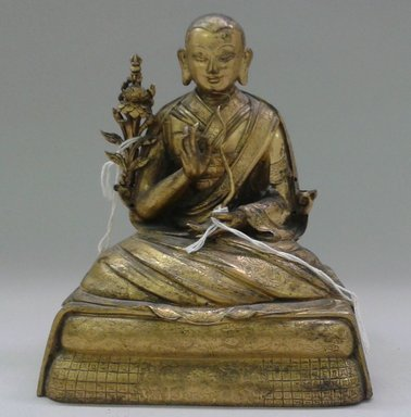 <em>Seated Monastic Figure</em>, ca. 1600. Gilt bronze, Height: 5 3/4 in. (14.6 cm). Brooklyn Museum, Gift of Joseph H. Hazen, 1993.104.3a-b. Creative Commons-BY (Photo: , CUR.1993.104.3a-b_front.jpg)