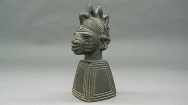 Yorùbá. <em>Bust (Ogo Elegba)</em>, 20th century. Wood, 6 7/8 x 2 7/8 x 3 1/2 in. Brooklyn Museum, Gift of Dorothy Robbins, 1993.180.11. Creative Commons-BY (Photo: Brooklyn Museum, CUR.1993.180.11.jpg)