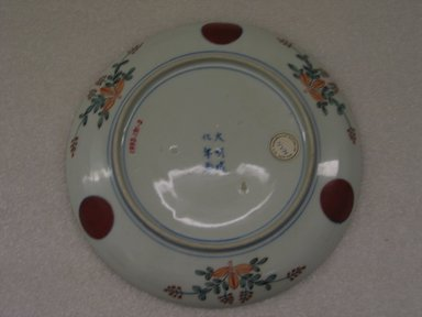 <em>Arita ware Dish in Kakiemon-style</em>, 20th century. Porcelain with overglaze polychrome enamel decoration, height: 1 3/16 in. Brooklyn Museum, Gift of Dr. and Mrs. George Liberman, 1993.191.2. Creative Commons-BY (Photo: Brooklyn Museum, CUR.1993.191.2_back.jpg)