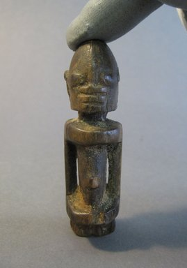 Dogon. <em>Male Figure</em>, 19th-20th century. Wood, 3 1/4 x 1 x diam: 1 1/8 in. (8.3 x 2.6 x diam: 2.8 cm). Brooklyn Museum, Gift of Bill and Gale Simmons, 1994.144.12. Creative Commons-BY (Photo: Brooklyn Museum, CUR.1994.144.12_front.jpg)