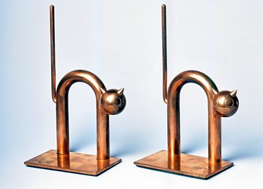 Walter von Nessen (American, born Germany, 1889-1943). <em>Cat Bookend, One of Pair</em>, 1930-1935. Copper-plated alloy, 7 3/8 x 4 1/2 x 2 1/2 in. (18.8 x 11.5 x 6.4 cm). Brooklyn Museum, H. Randolph Lever Fund, 1994.156.5. Creative Commons-BY (Photo: , CUR.1994.156.4-5.jpg)