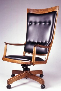 Sam Maloof. <em>Armchair</em>, 1985. Walnut, leather, metal, height: 50 3/4 in. Brooklyn Museum, Gift of Martha J. Fleischman, 1994.161. Creative Commons-BY (Photo: Brooklyn Museum, CUR.1994.161.jpg)