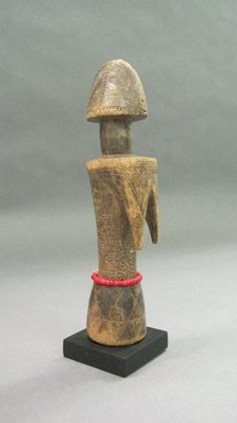 Mossi. <em>Doll</em>, 20th century. Wood, glass beads, cordage, applied surface, 8 1/2 x 1 3/4 x 1 3/4 in. (21.6 x 4.5 x 4.5 cm). Brooklyn Museum, Gift of Drs. Noble and Jean Endicott, 1994.183.6. Creative Commons-BY (Photo: Brooklyn Museum, CUR.1994.183.6.jpg)