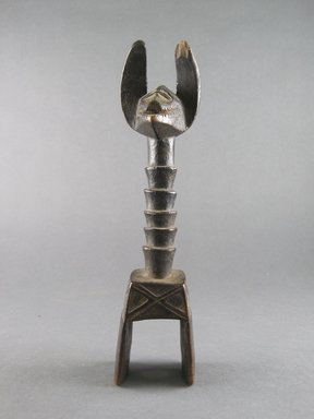Guro. <em>Heddle Pulley</em>, 20th century. Wood, height: 8 1/2 in. Brooklyn Museum, Gift of Dorothy Robbins, 1994.184.5. Creative Commons-BY (Photo: Brooklyn Museum, CUR.1994.184.5_front.jpg)