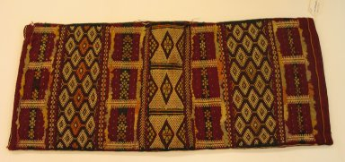 Berber, Zemmour Tribe. <em>Bolster Cover</em>, mid-20th century. Wool, flat weave, cotton brocade, sequins, 17 1/2 x 14 1/2 x 33 7/8 in. (44.5 x 36.8 x 86 cm). Brooklyn Museum, Gift of Dr. Virgil H. Bird, 1994.189.1. Creative Commons-BY (Photo: Brooklyn Museum, CUR.1994.189.1.jpg)