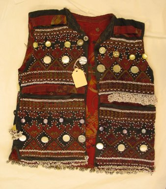 <em>Vest</em>, mid-20th century. Cotton cloth, buttons, metal ornaments, and beads Brooklyn Museum, Gift of Dr. and Mrs. John P. Lyden, 1994.197.9. Creative Commons-BY (Photo: Brooklyn Museum, CUR.1994.197.9_front.jpg)