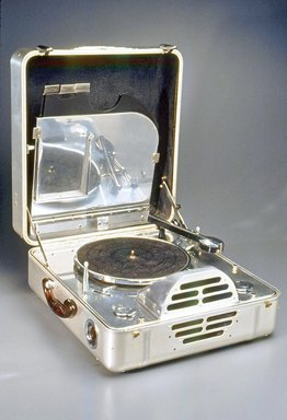 John Vassos (American, born Romania, 1898-1985). <em>RCA Victor Special Model K, Portable Electric Phonograph</em>, ca. 1935. Aluminum, various metals, plastic, felt, leather, closed: 7 3/4 x 16 1/4 x 17 1/4 in. (19.7 x 41.3 x 43.8 cm). Brooklyn Museum, Gift of Benno Bordiga, by exchange, 1995.14. Creative Commons-BY (Photo: Brooklyn Museum, CUR.1995.14.jpg)