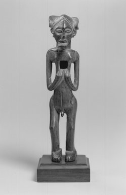 Chokwe. <em>Standing Male Figure (Tskibinda Ilunga)</em>, 19th century. Wood, organic encrustations, 11 3/4 x 2 3/4 x x 3 in. (29.9 x 7.0 x 7.6cm). Brooklyn Museum, Gift of Corice and Armand P. Arman, 1995.169.1. Creative Commons-BY (Photo: Brooklyn Museum, CUR.1995.169.1_print_front_bw.jpg)