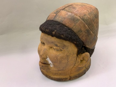 Makonde artist. <em>Helmet Mask</em>, 20th century. Wood, human hair, pigment, leather, 7 x 7 1/2 x 10 1/2 in. (17.8 x 19.0 x 26.7 cm). Brooklyn Museum, Gift of Drs. Noble and Jean Endicott, 1995.173.7. Creative Commons-BY (Photo: , CUR.1995.173.7_view01.jpg)