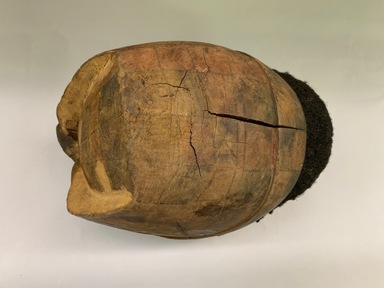 Makonde artist. <em>Helmet Mask</em>, 20th century. Wood, human hair, pigment, leather, 7 x 7 1/2 x 10 1/2 in. (17.8 x 19.0 x 26.7 cm). Brooklyn Museum, Gift of Drs. Noble and Jean Endicott, 1995.173.7. Creative Commons-BY (Photo: , CUR.1995.173.7_view05.jpg)