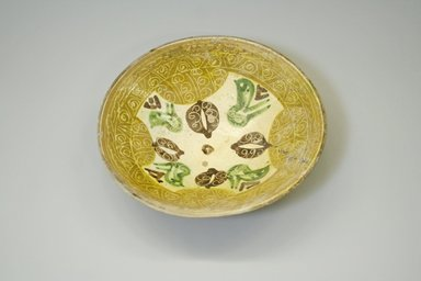 <em>Bowl</em>, 10th-11th century. Earthenware and slip, 2 13/16 x 11 in. (7.2 x 27.9 cm). Brooklyn Museum, Gift of Mena Rokhsar in memory of Ebrahim Khalil Rokhsar, 1995.187.3. Creative Commons-BY (Photo: Brooklyn Museum, CUR.1995.187.3.jpg)