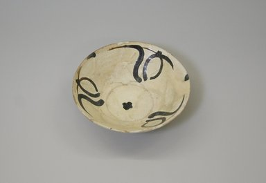 <em>Bowl</em>, 9th-10th century. Ceramic, earthenware, slip, 2 x 6 1/4 in. (5.1 x 15.8 cm). Brooklyn Museum, Gift of Mena Rokhsar in memory of Ebrahim Khalil Rokhsar, 1995.187.8. Creative Commons-BY (Photo: Brooklyn Museum, CUR.1995.187.8.jpg)