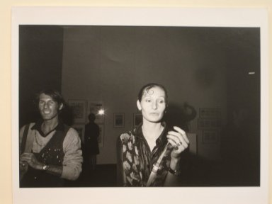 Garry Winogrand (American, 1928-1984). <em>Untitled (Woman and Man in a Dark Gallery), from Women are Beautiful Series</em>. Gelatin silver photograph, sheet: 11 x 14 in. (27.9 x 35.5 cm). Brooklyn Museum, Gift of Mitchell F. Deutsch, 1995.206.12. © artist or artist's estate (Photo: Brooklyn Museum, CUR.1995.206.12.jpg)
